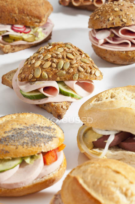 Different bread rolls, sandwich with mixed cold cuts — Stock Photo