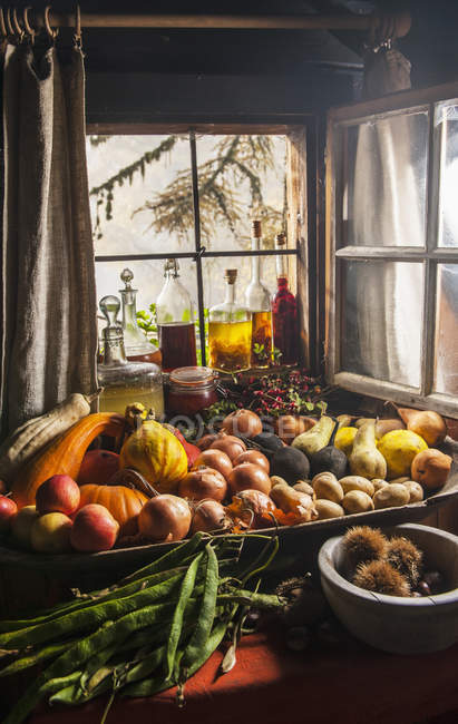 Various harvested fruits in garden indoors — Stock Photo