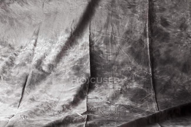 Grey fabric background, close up — Stock Photo