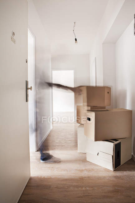 Cardboard boxes in new house — Stock Photo