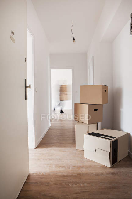 Cardboard boxes in corridor — Stock Photo