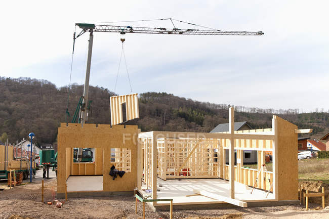 Europe, Germany, Rhineland Palantinate, Installing and fixing wooden walls of prefabricated house — Stock Photo