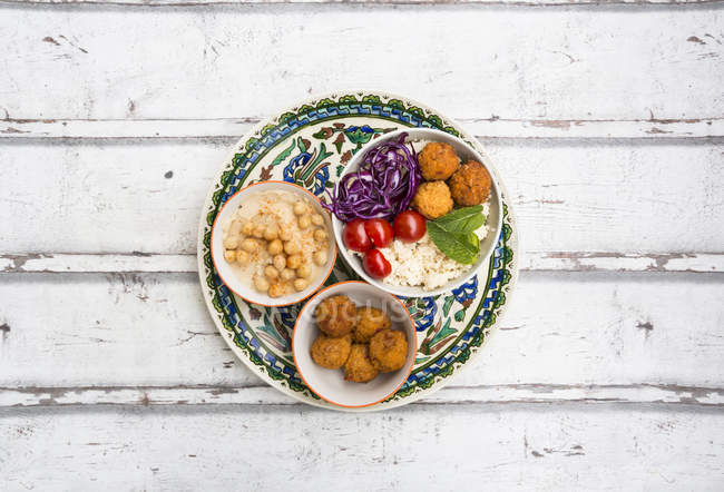 Sweet potato balls, Couscous, Hummus and vegetables in bowls — Stock Photo
