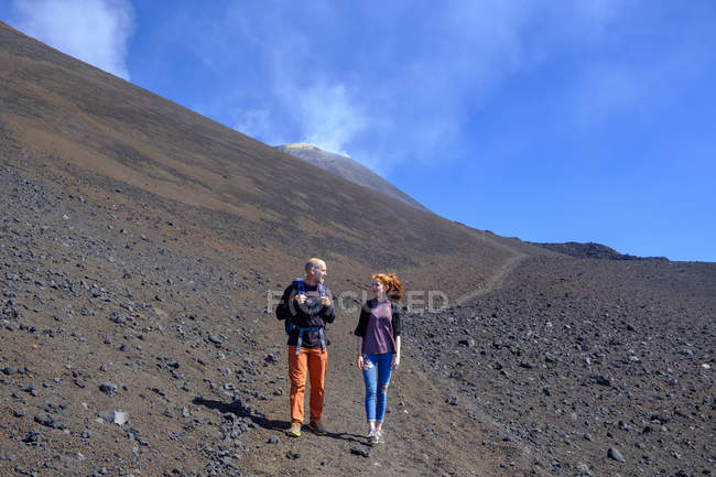 Italy, Sicily, Mount Etna, father and daughter hiking — Stock Photo