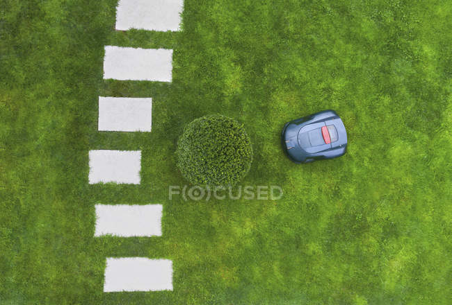 Top view of robotic lawn mower on meadow — Stock Photo