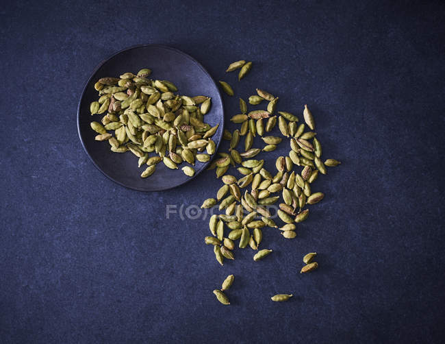 Top view of Cardamom on blue tabletop — Stock Photo