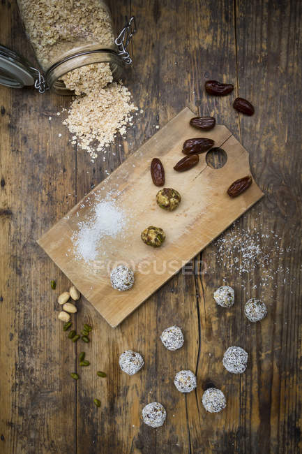 Bliss Balls with dates, pistachio, oat flakes and coconut flakes — Stock Photo