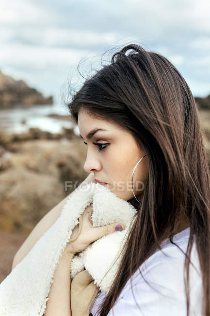 Sad young woman on the beach — Stock Photo