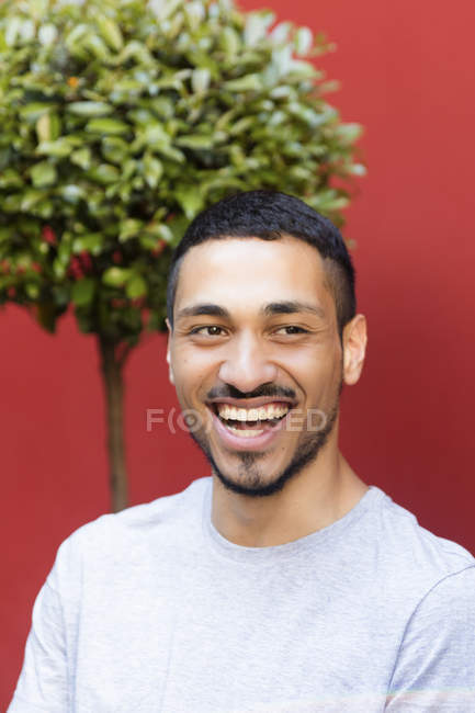 Portrait of laughing man outside — Stock Photo