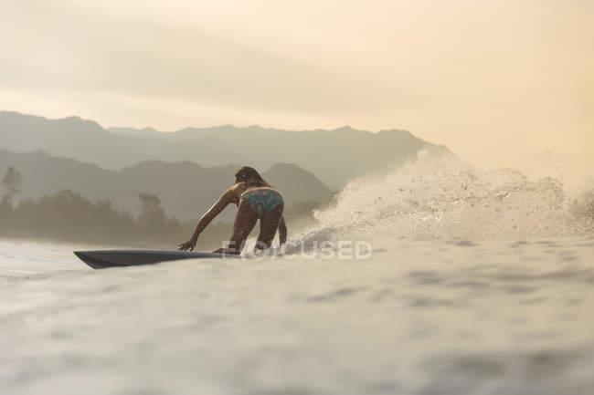 Indonesia, Sumatra, female surfer in the evening light — Stock Photo