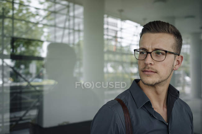 Portrait of pensive young businessman wearing glasses — Foto stock