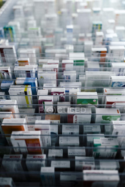 Medicine in shelves in commissioning machine in pharmacy — Stock Photo