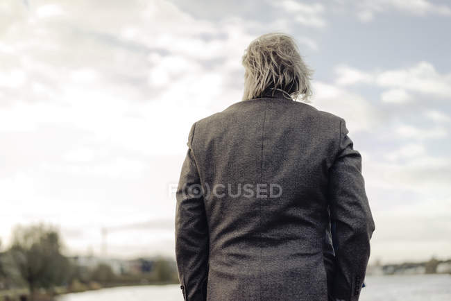 Rear view of senior man at lake — Stock Photo