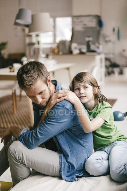 Son consoling sad father at home — Stock Photo