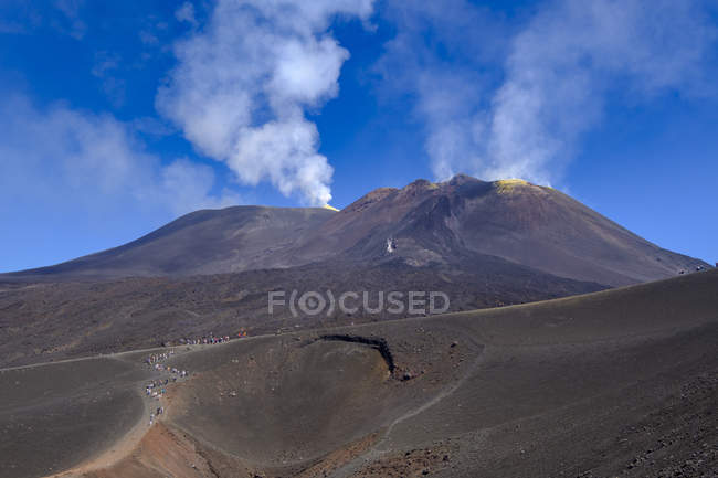 Italy, Sicily, Mount Etna, volcanic crater, tourists — Stock Photo