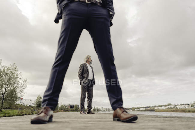 Two businessmen standing on jetty — Stock Photo