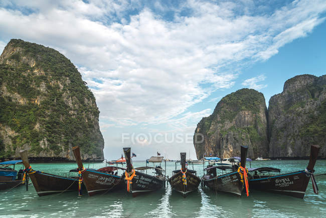Thailand, Phi Phi Islands, Ko Phi Phi, moored long-tail boats in a row — Stock Photo