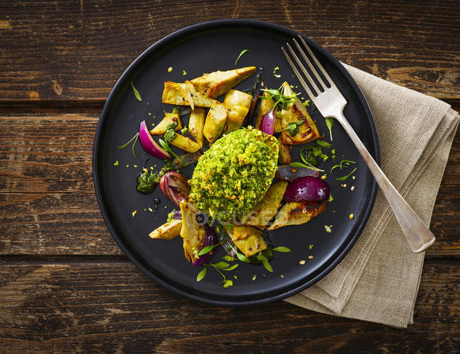 Filled and gratinated avocado with egg and artichoke — Stock Photo