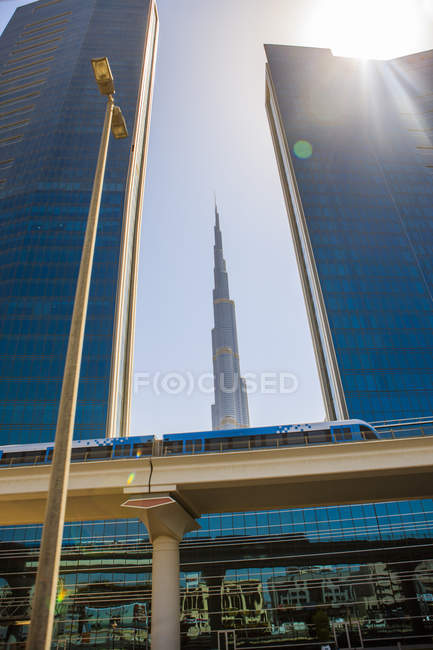 United Arab Emirates, Dubai, Burj Khalifa and elevated railway  at daytime — стоковое фото