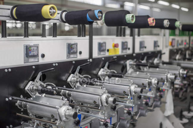 Close up of Thread machine at the factory — Stock Photo