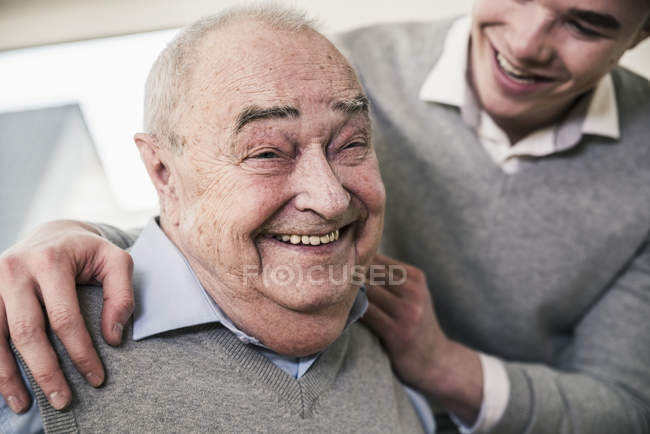 Portrait of happy senior man with young man — Stock Photo