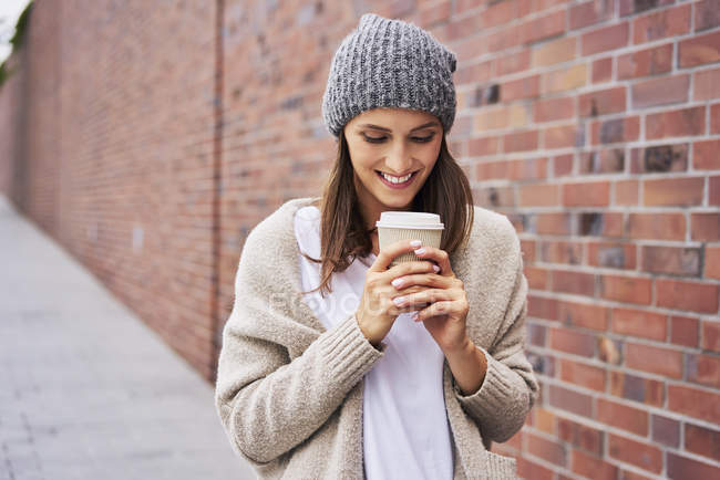 Happy woman with coffee to go — Stock Photo