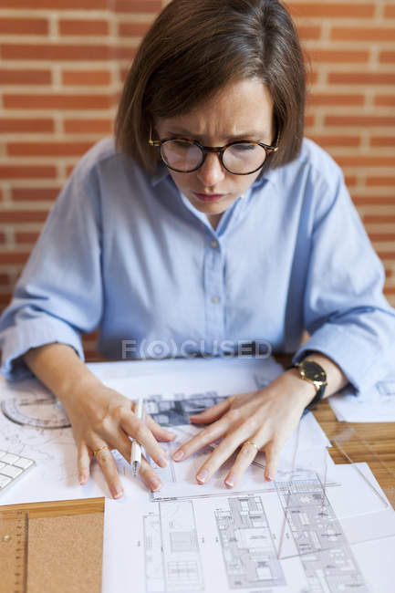Young woman working in architecture office — Stock Photo
