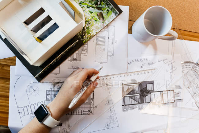 Hand of young architect worcing on a blueprint — Stock Photo