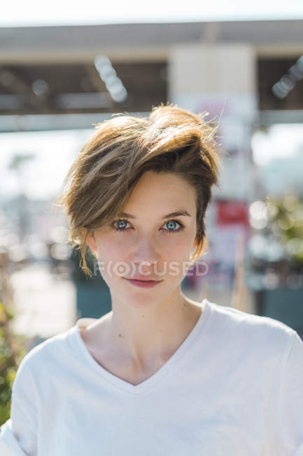 Portrait of woman with blue eyes and short hair — Stock Photo
