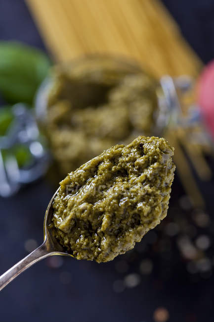 Spoon of basil pesto, close-up — Stock Photo