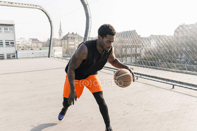 African american Basketball player in action on court — Stock Photo