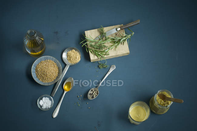 Homemade mustard, sorts, spoons, various ingredients — Stock Photo