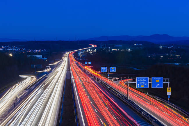 Germany, Baden-Wuerttemberg, Autobahn A8 near Wendlingen in the evening, light trails — Stock Photo