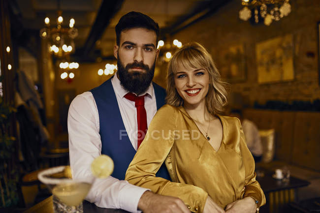 Portrait of elegant couple in a bar — Stock Photo