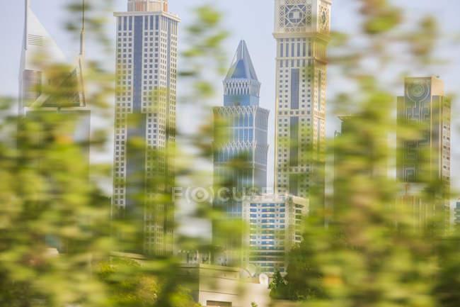 United Arab Emirates, Dubai, Cityscape and blurred trees  at daytime — Stock Photo