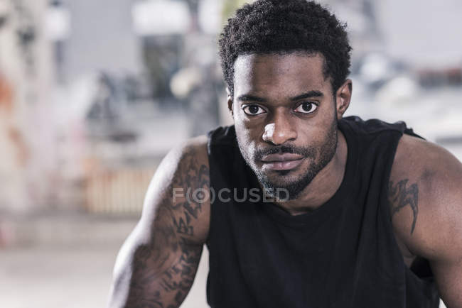 Portrait of confident african american man with tattoos — Stock Photo