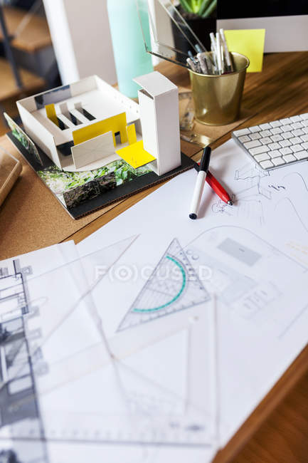 Blueprints and pens on an architect's desk — Stock Photo