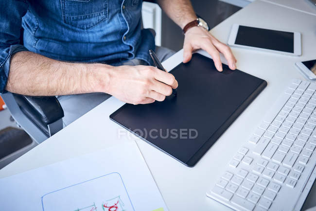 Close-up of graphic designer sketching website layout — Stock Photo