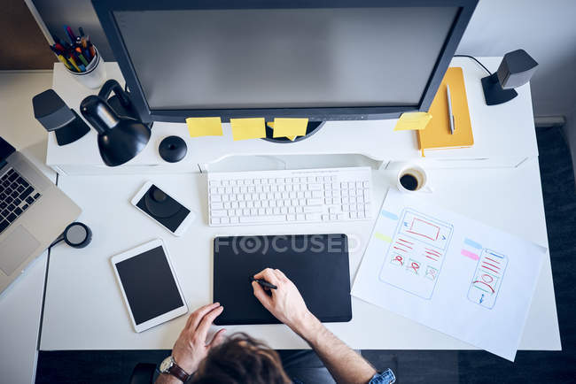 Overhead view of web designer developing website — Stock Photo