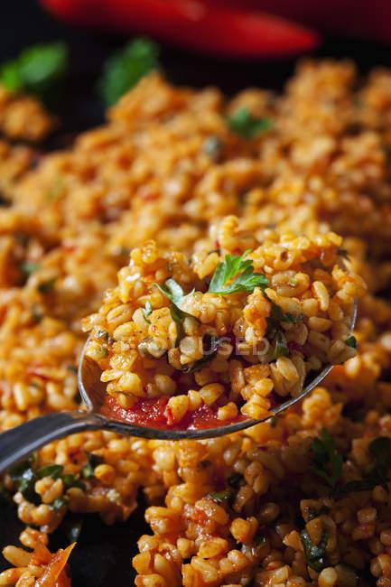 Spoon of bulgur wheat salad, close-up — Stock Photo