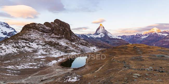 Switzerland, Valais, Zermatt, Matterhorn, Lake Riffelsee in the morning — Stock Photo