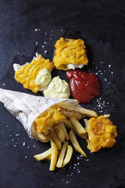 Fish and chips with remoulade and ketchup — Stock Photo