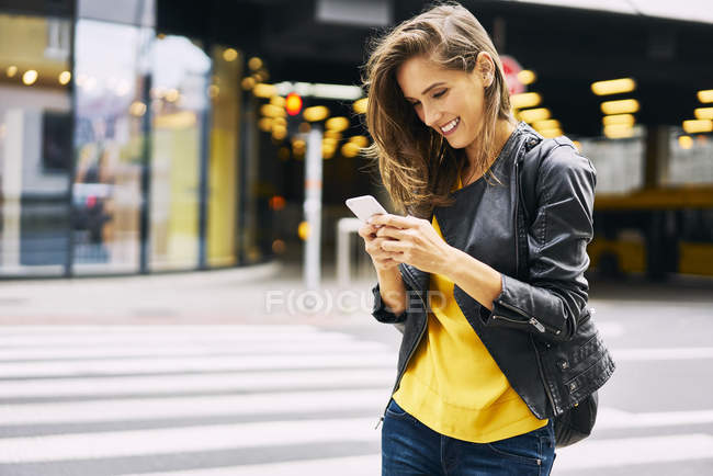 Happy woman looking at cell phone — Stock Photo