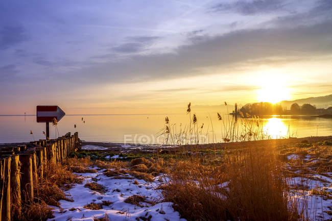 Switzerland, Thurgau, Lake Constance, Romanshorn in winter at sunset — Stock Photo