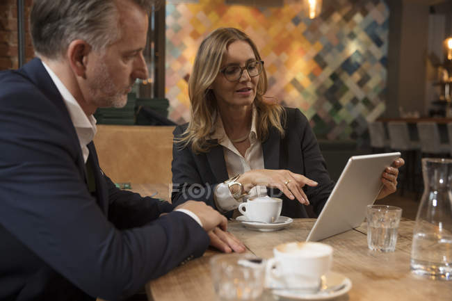 Two business people having meeting in a restaurant — Stock Photo