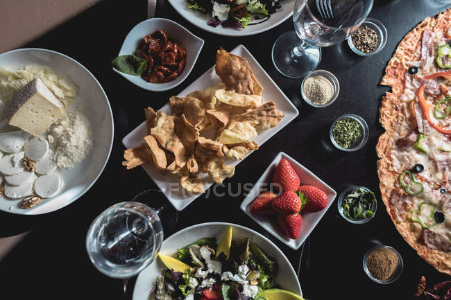 Table with italian food, salads and snacks — Stock Photo