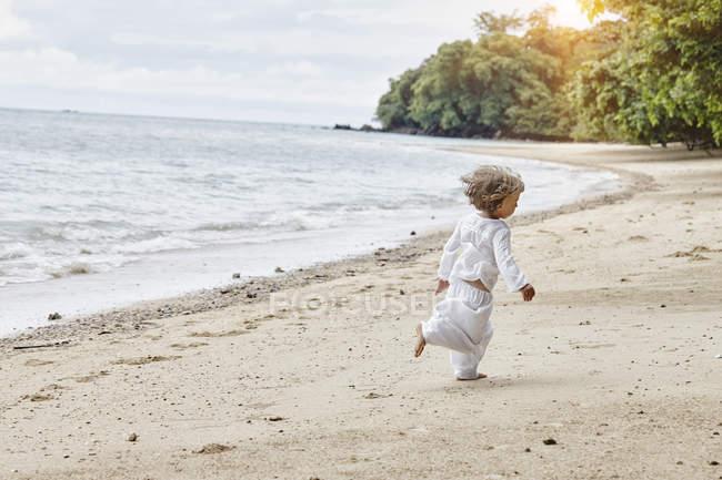 Thailand, Ko Yao Noi, little girl running on the beach — Stock Photo