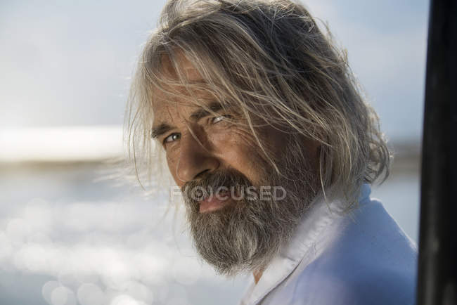 Portrait of a handsome senior man on the beach — Stock Photo