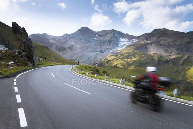 Austria, Salzburg State, biker on Grossglockner High Alpine Road — Stock Photo