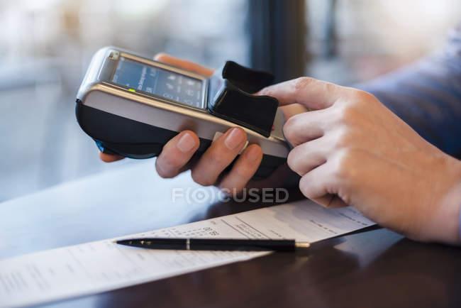 Man using credit card reader, close-up — Stock Photo
